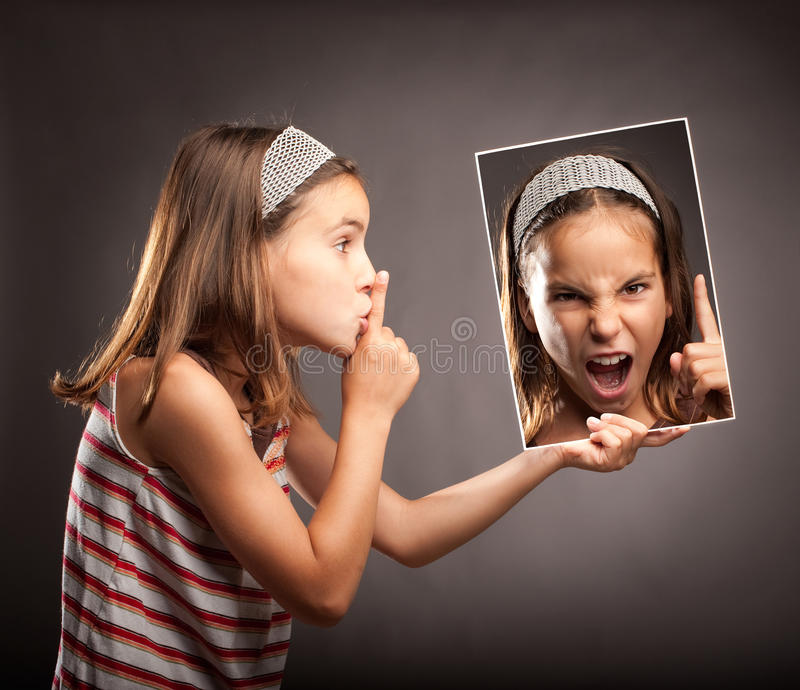 Little girl showing silence gesture royalty free stock photography