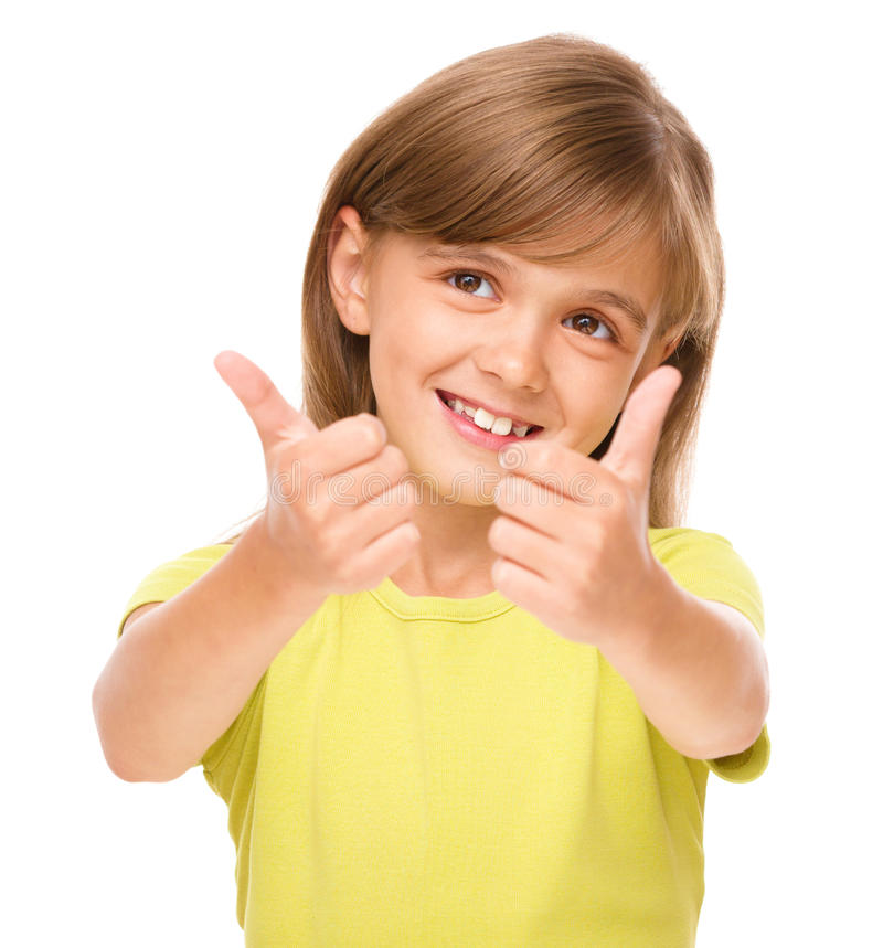 Little girl is showing thumb up sign. Using both hands, isolated over white royalty free stock photos