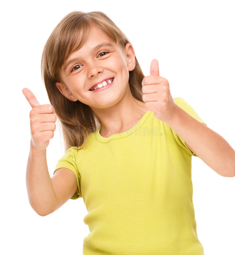 Little girl is showing thumb up sign. Using both hands, isolated over white royalty free stock images