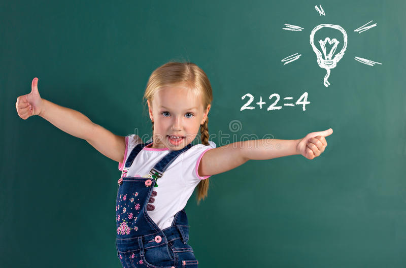 Little girl showing thumbs up royalty free stock photo