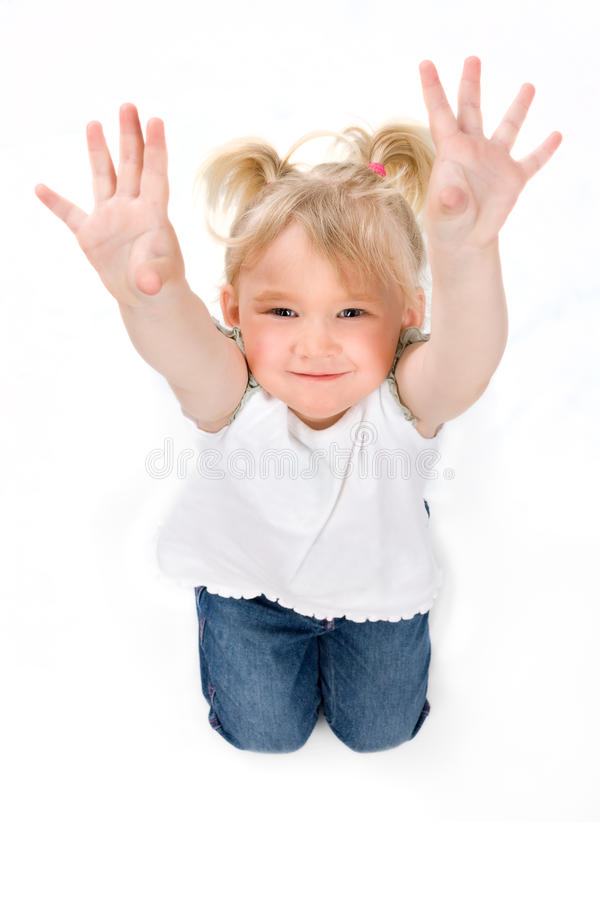 Little girl shows her hands stock images