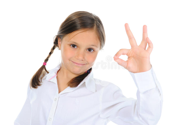 Little girl shows sign okay. Isolated on a white background stock photo