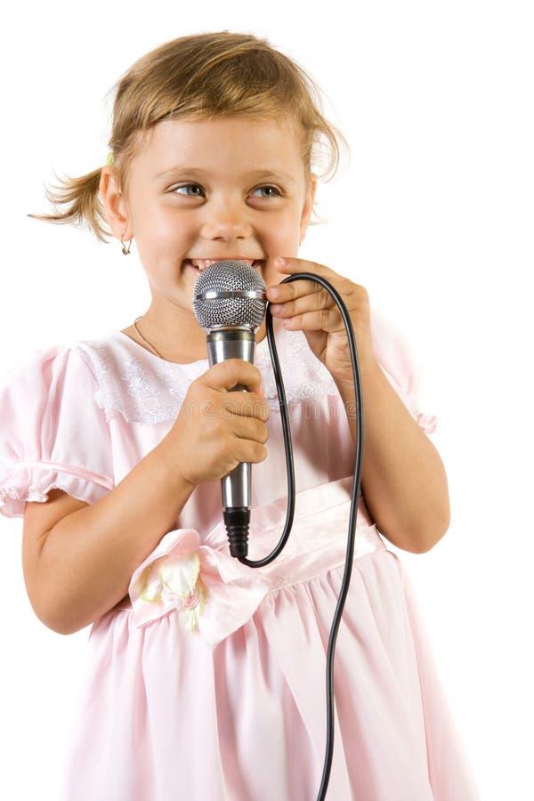 Little girl singing. stock photos