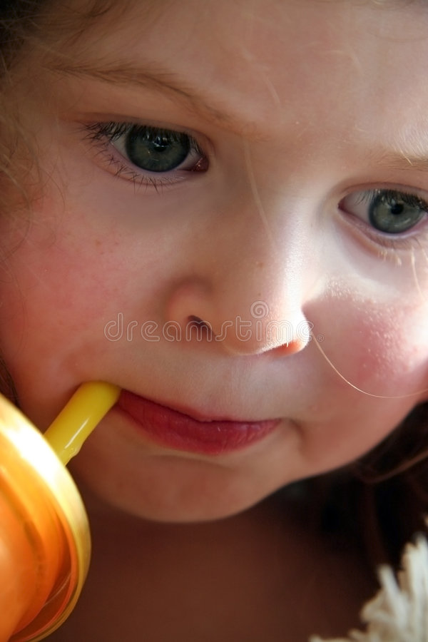 Download Little Girl Sipping From A Straw Stock Image - Image: 4171707