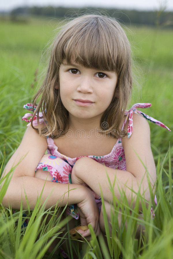 Download Little Girl Sitiing In Meadow Stock Photo - Image: 8289706