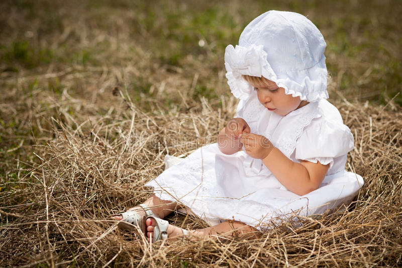 Download A Little Girl Sits In The Nest Stock Image - Image: 28734087