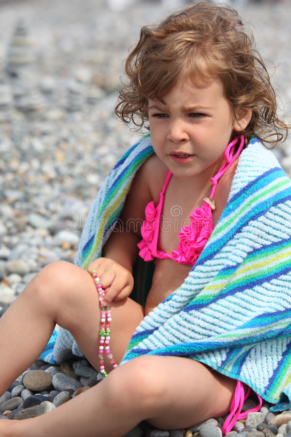 Download Little girl sits on pebble stock photo. Image of diaper - 10694202