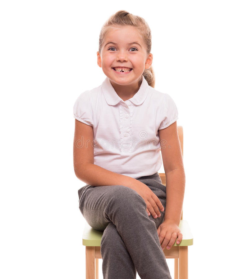 Download Little Girl Sitting On A Chair And Smiling Stock Photo - Image: 34415580