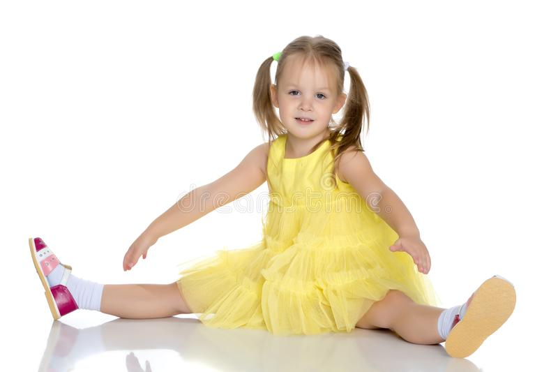 Little girl is sitting on the floor. royalty free stock photography