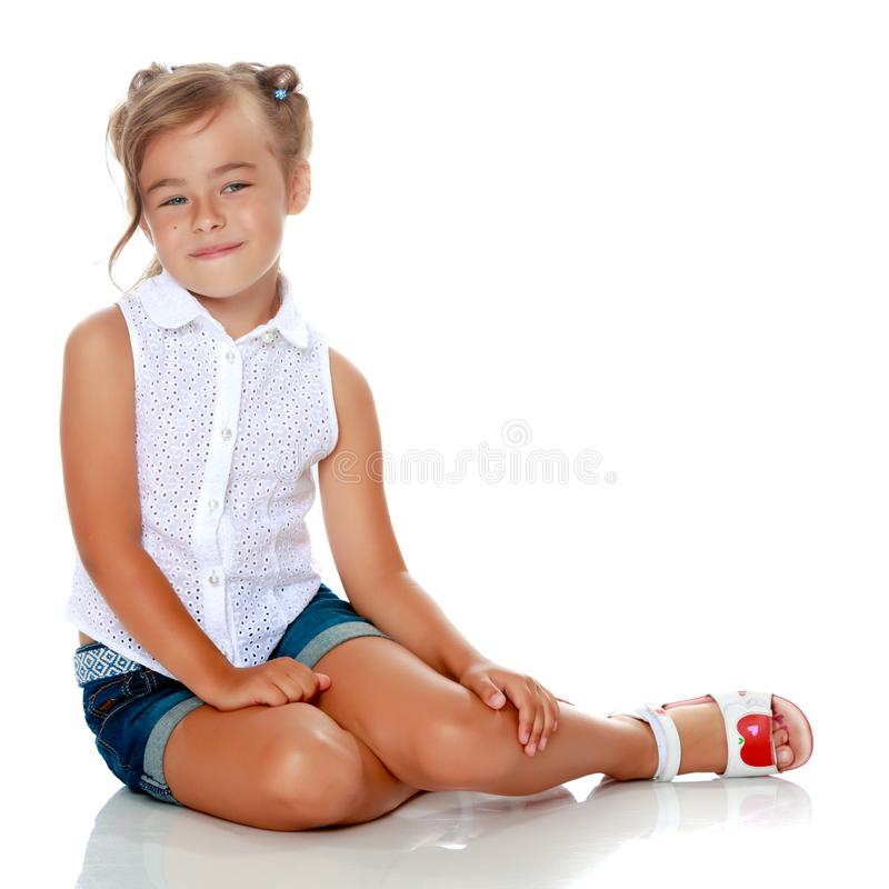 Little girl is sitting on the floor. royalty free stock images