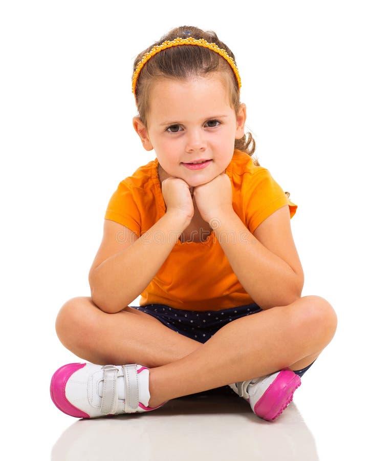 Little girl sitting floor stock image