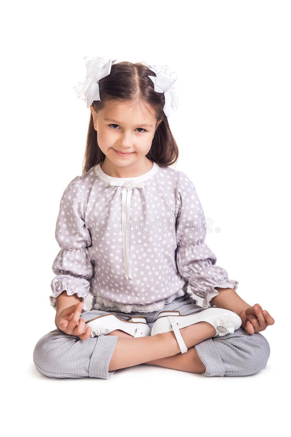 Little girl sitting on the floor stock photo