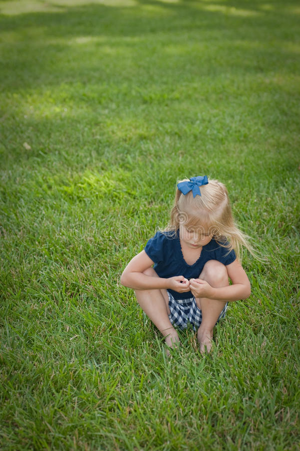 Download Little Girl Sitting In Grass Stock Photo - Image of natural, beauty: 9833446