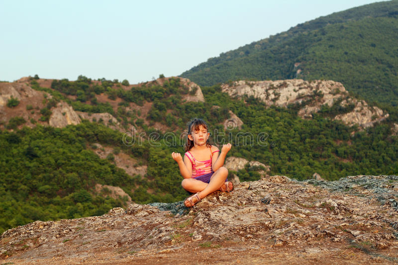Download Little Girl Sitting On A Mountain Top Stock Photo - Image of preschooler, cute: 26267716