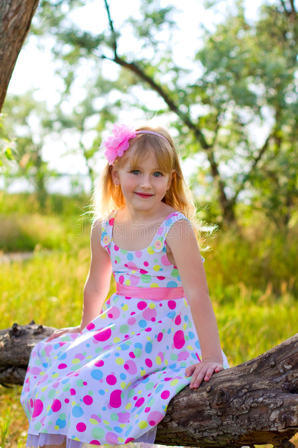 Free Little Girl Sitting On A Tree Branch In A Summer Park Royalty Free Stock Images - 32324289