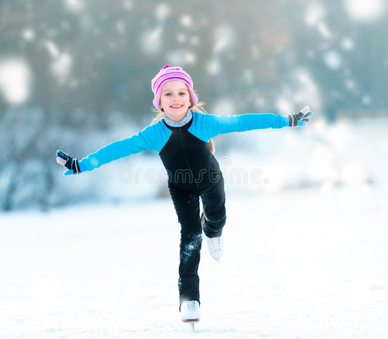 Little girl skating royalty free stock image