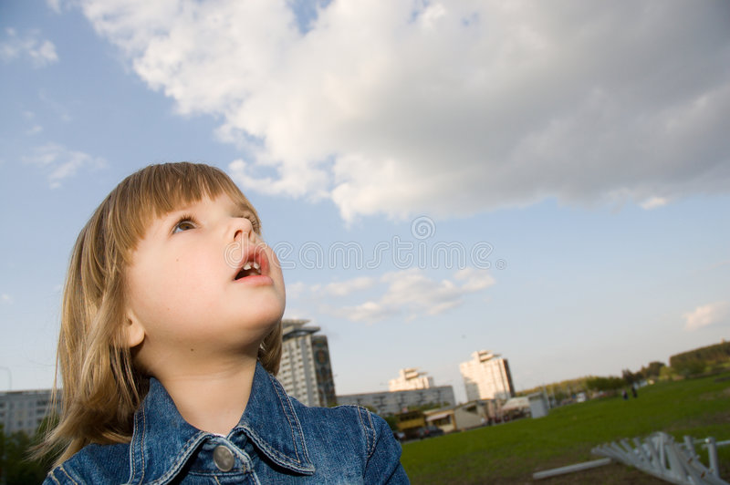 Little girl and the sky stock image