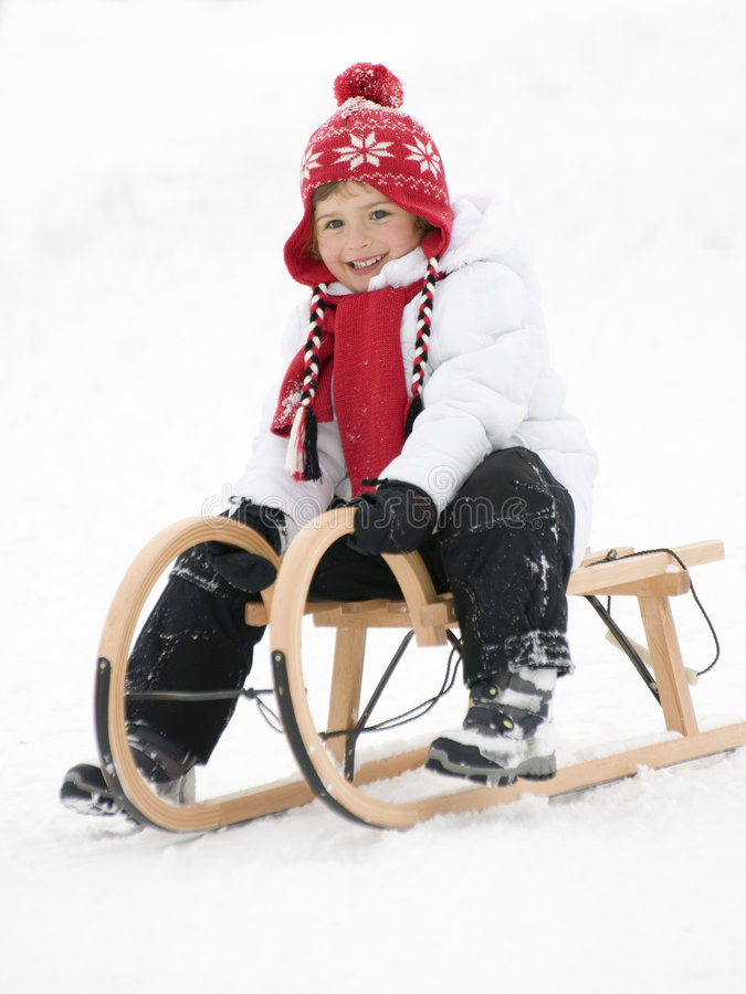 Little girl on sledge royalty free stock photos