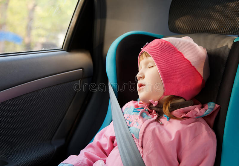 Little girl sleeping in a car royalty free stock image