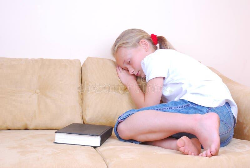 Little girl sleeping on couch stock image