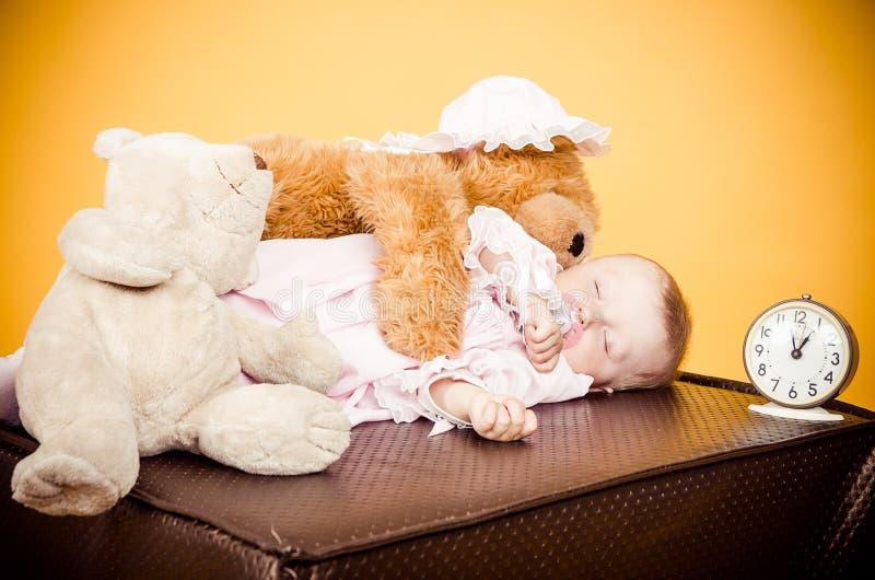 Little girl sleeping studio royalty free stock images