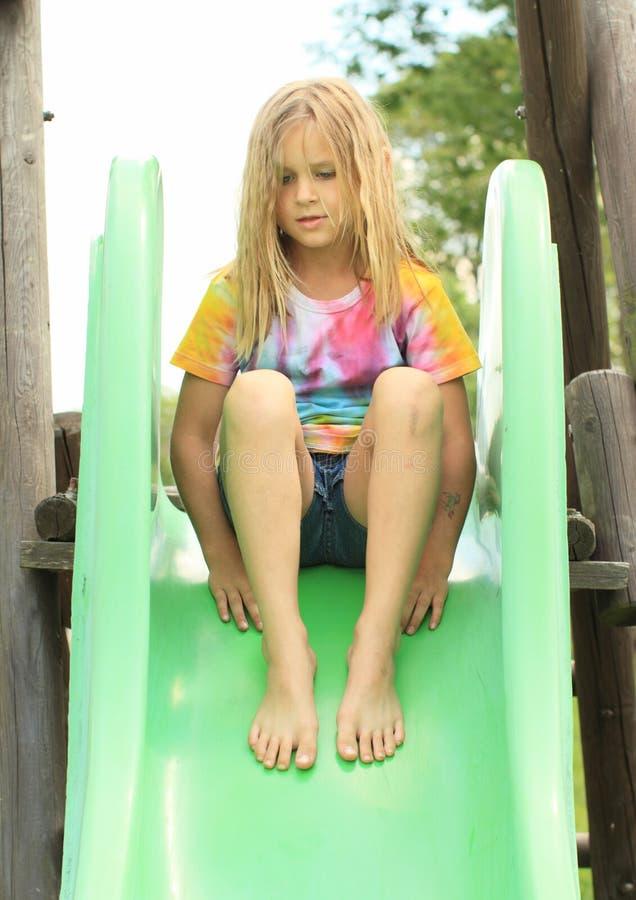 Little girl on a slide stock image
