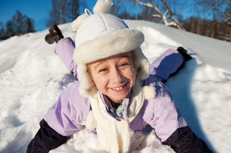 Download Little Girl Sliding In The Snow Stock Photo - Image: 12574464