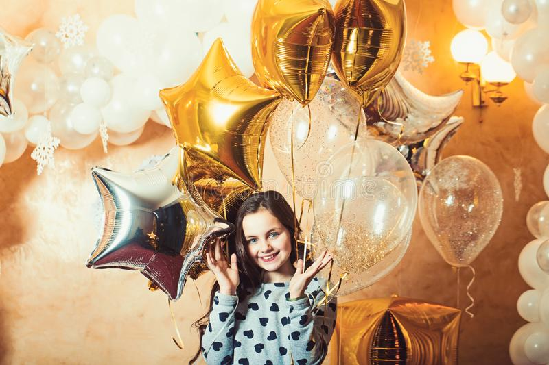 Little girl smile with golden silver star balloons, christmas. Happy child celebrate new year and xmas holidays. New royalty free stock photos