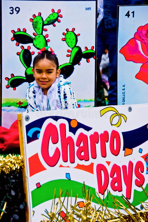 Little girl smiles on a parade float stock photography