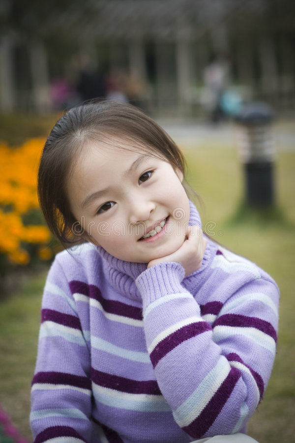 Little girl smiles pleasantly stock image