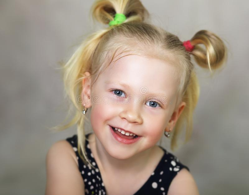 Little girl smiling at camera royalty free stock image