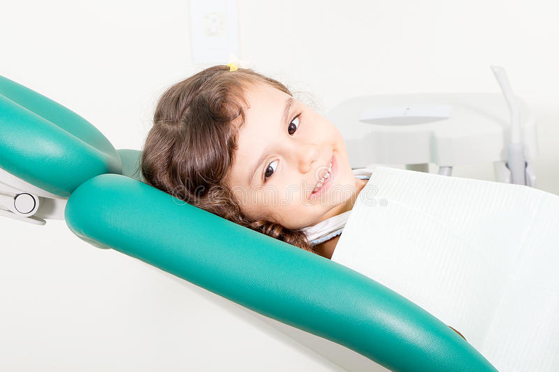 Little girl smiling at dental clinic royalty free stock photos