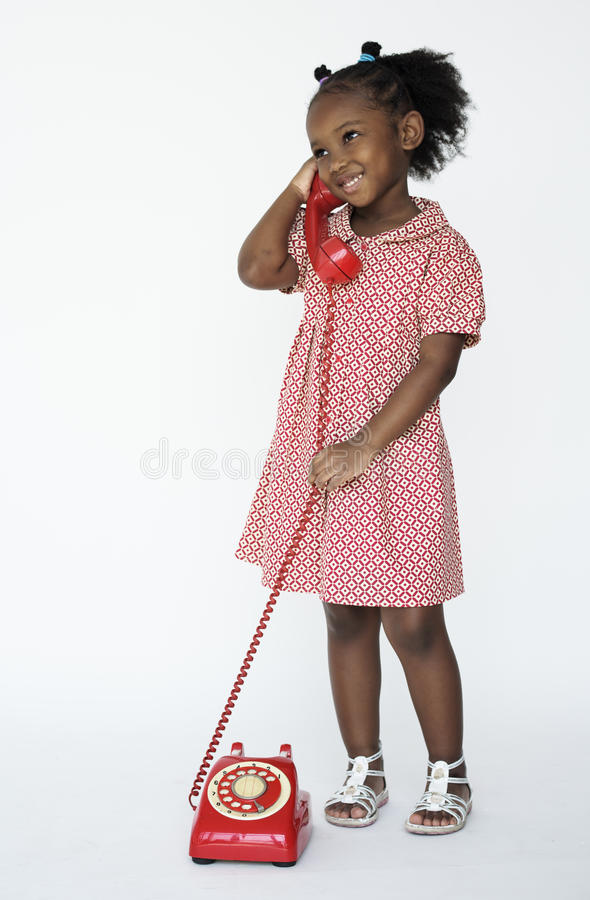 Little Girl Smiling Happiness Talking on the Phone Communication royalty free stock image