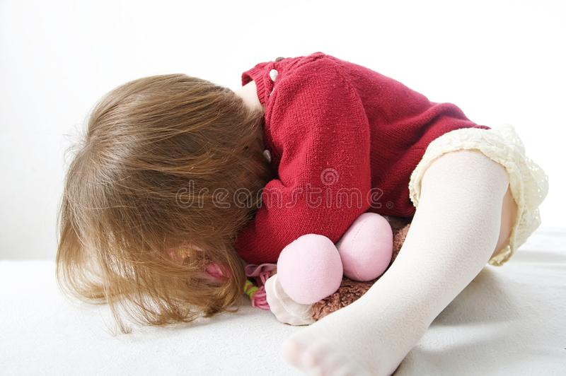 Little baby girl playing hide and seek. cute baby royalty free stock images