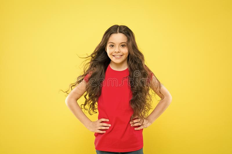 Little girl smiling. happy girl with long curly hair. childhood happiness. summer fashion and beauty. hipster child royalty free stock photos