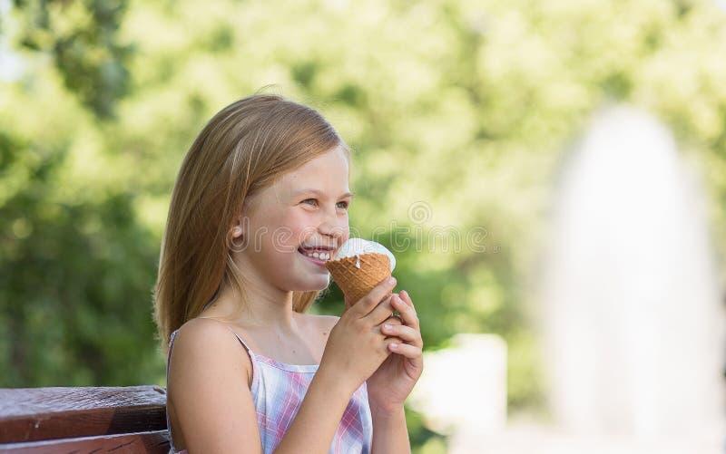 Little girl smiling holding ice cream. royalty free stock photo