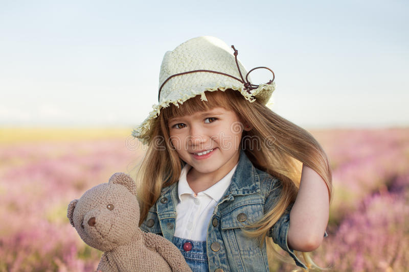 Little girl smiling in the lavender field stock image
