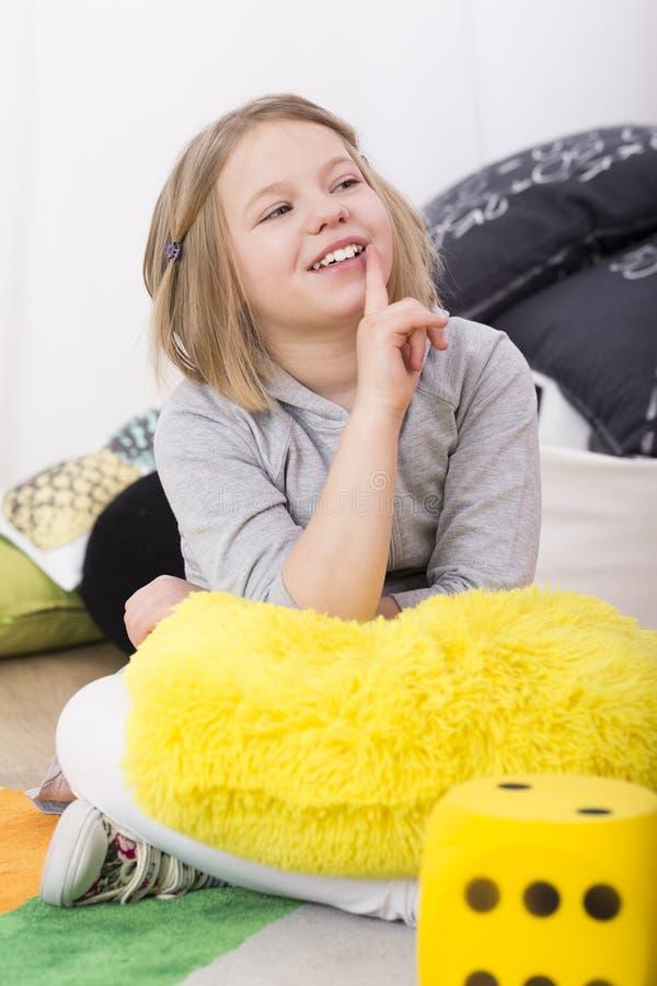 Little girl smiling at teacher royalty free stock image