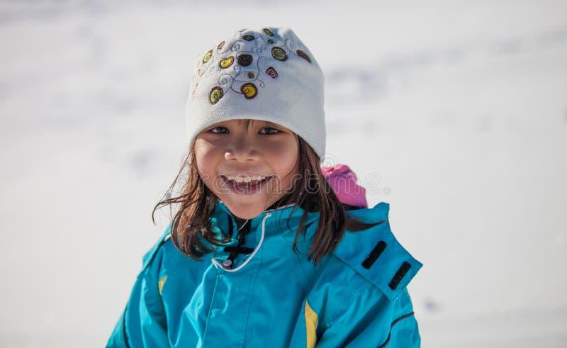 Little Girl Smiling In Winter. An asian little girl smiling in winter clothing outdoor stock photography