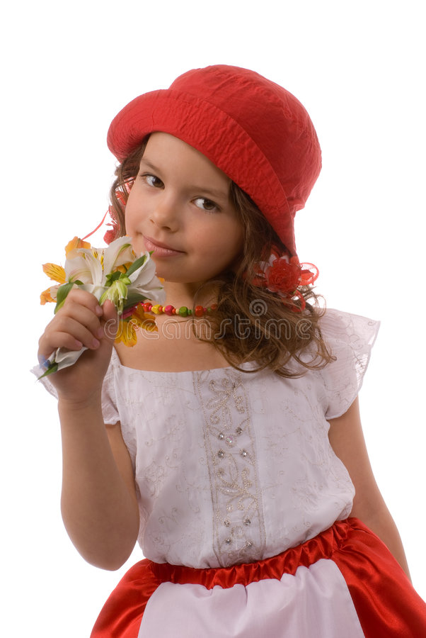 Little girl sniffing flowers stock image