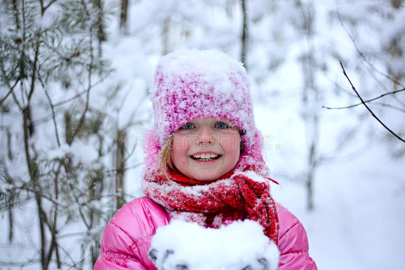 Little girl in snow . royalty free stock images
