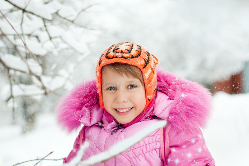 The little girl in the snow stock photo