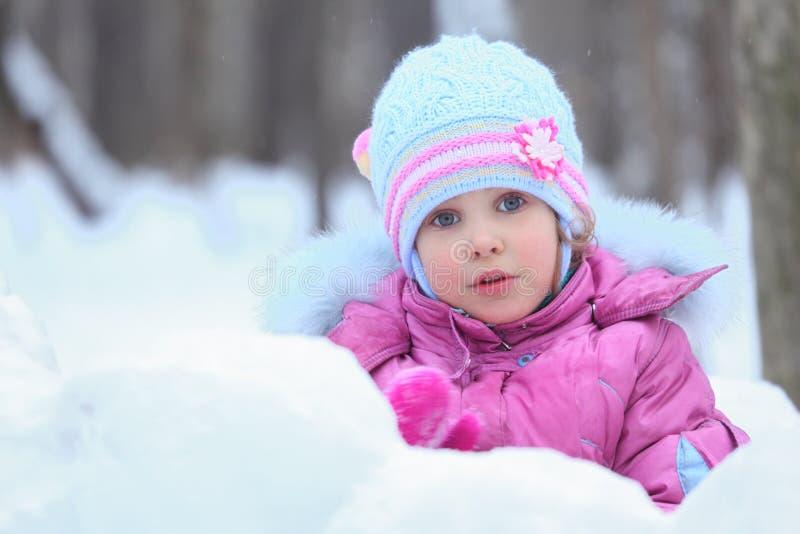 Little girl in snow stock photo