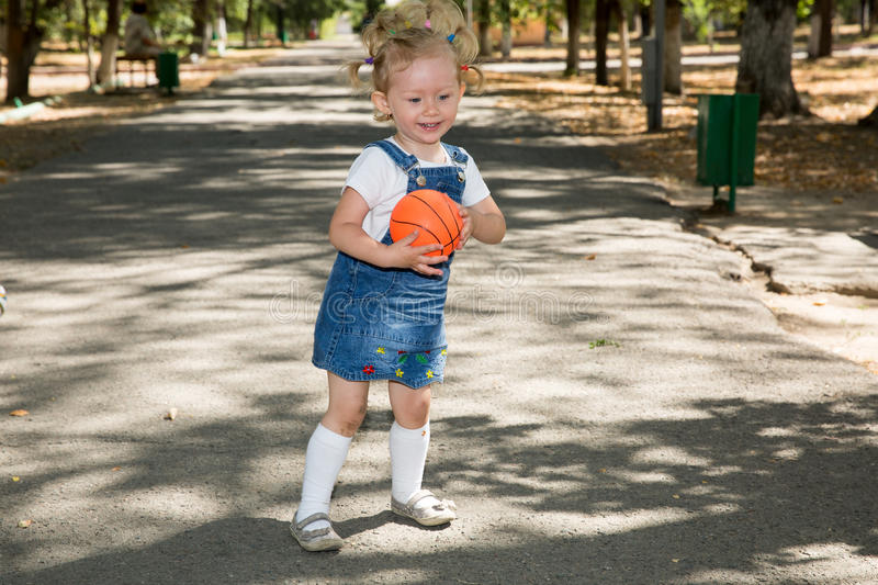 Little girl with soccer ball in park on nature at summer. royalty free stock images
