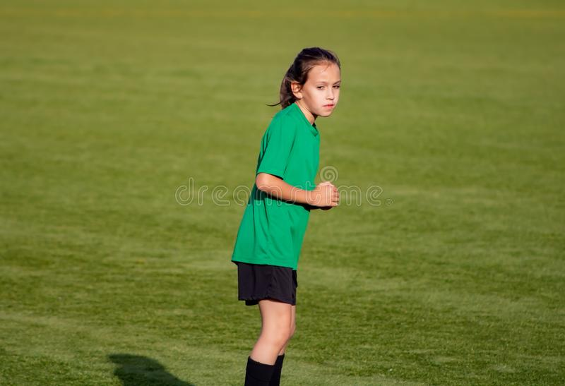 Little girl in a soccer training. In Burriana light beautiful cute game ball player girls kid practice tired female childhood youth exercise uniform person stock photography