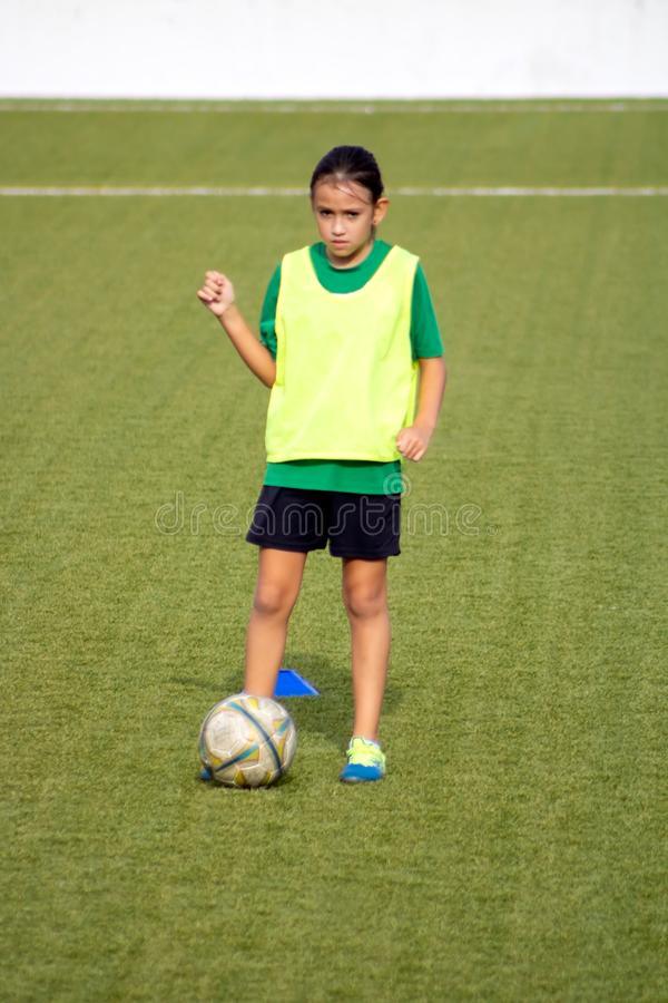 Little girl in a soccer training. In Burriana, light, beautiful, cute, game, ball, player, girls, kid, practice, tired, female, childhood, youth, exercise stock images