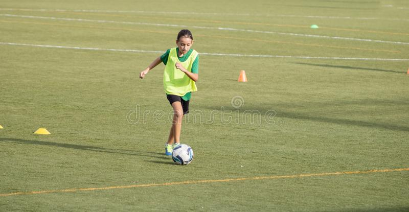 Little girl in a soccer training. In Burriana, light, beautiful, cute, game, ball, player, girls, kid, practice, tired, female, childhood, youth, exercise stock photos
