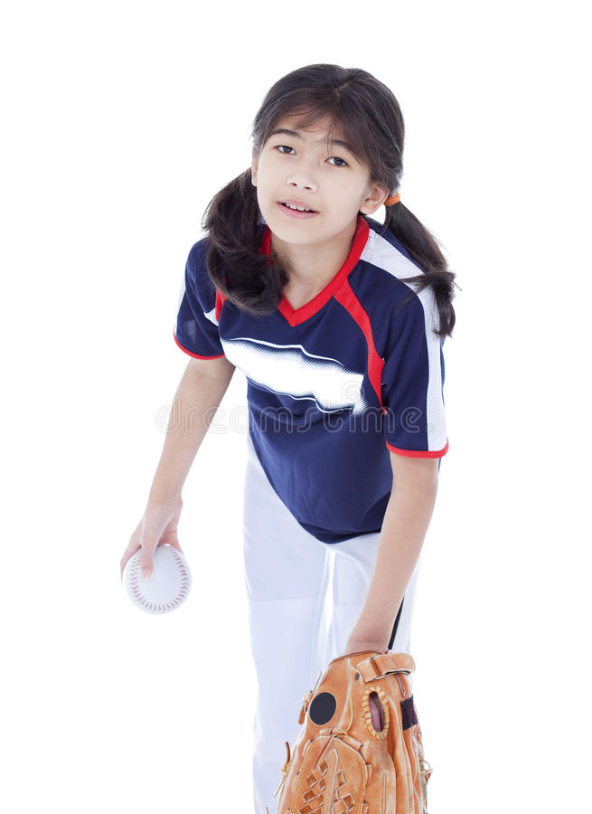 Download Little Girl In Softball Team Uniform Ready To Throw A Pitch Stock Image - Image: 29253097
