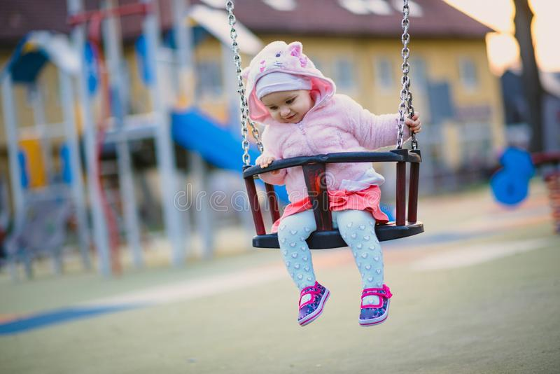 Little girl spending fantastic time on playground. Happy childhood. Authentic image. Baby, toddler, caucasian, kid, park, fun, outdoor, summer, joy, cute stock photos