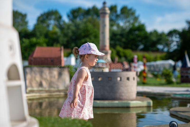 Little girl spending fantastic time on playground. Happy childhood. Authentic image. Baby, toddler, caucasian, kid, park, fun, outdoor, summer, joy, cute royalty free stock photo
